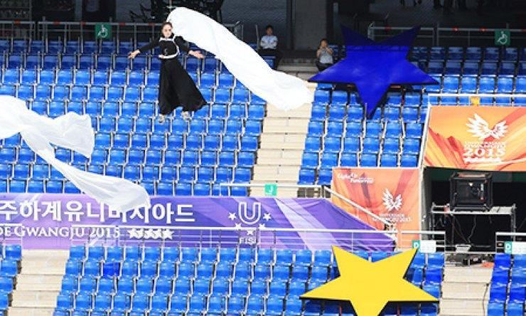 Organizers prepare the Gwangju Universiade Main Stadium for the international sporting event's opening ceremony, Friday. / Yonhap
