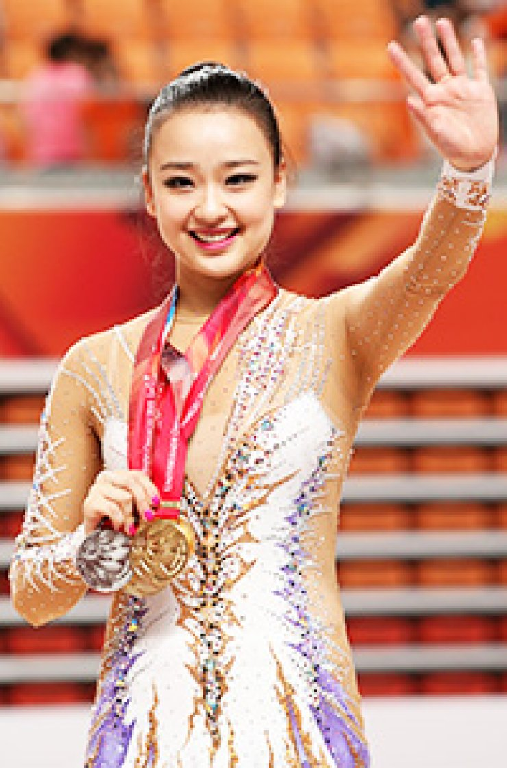 Rhythmic gymnast Son Yeon-jae poses with her gold medals at the awards ceremony in Kwangju Women's University Gymnasium, Monday. / Courtesy of GUOC