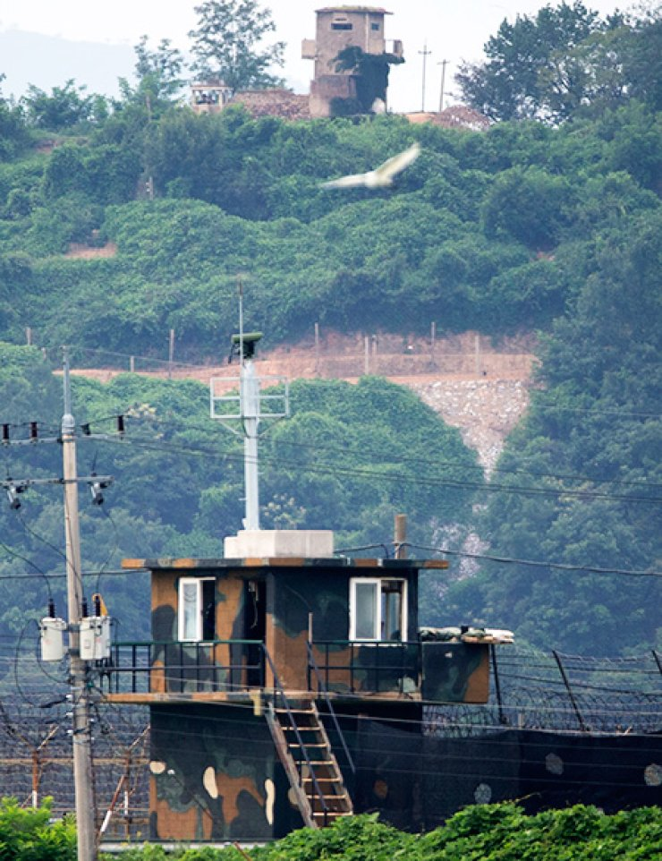 A North Korean guard post is seen on the top of a hill in the Demilitarized zone near Paju, Gyeonggi Province, Monday. / Yonhap