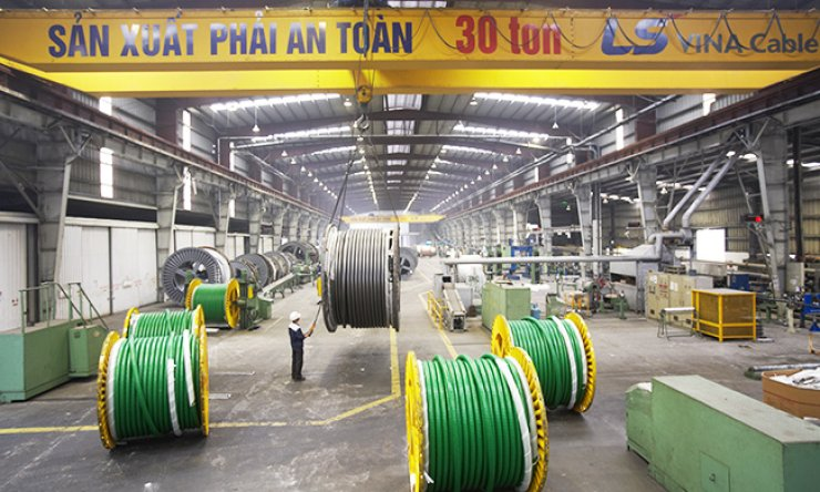 Workers produce transmission cables at a manufacturing facility of LS-VINA, the Vietnamese subsidiary of LS Cable & System, in Haiphong, Vietnam. / Courtesy of LS C&S