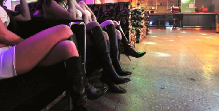 Female employees wait for customers at a club near a U.S. military base in Dongducheon, Gyeonggi Province. / Korea Times photo by Won Yoo-hyun