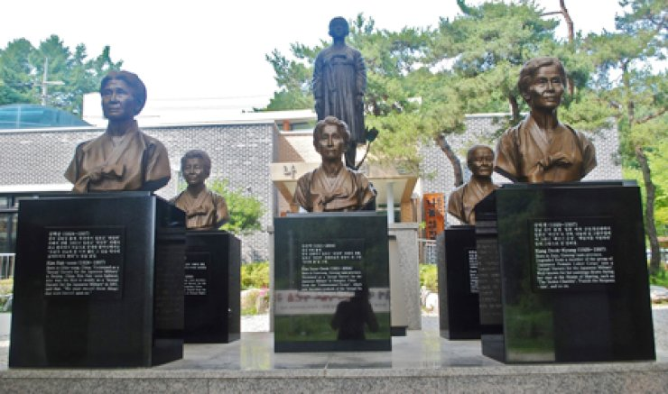 Statues of women who were forced into sex slavery for Japanese troops during World War II stand in the House of Sharing in Gwangju, Gyeonggi Province. The home for living 'comfort women' includes the world's first museum dedicated to the issue. / Korea Times file