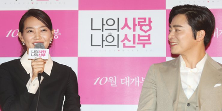 Shin Min-a, left, and Jo Jeong-seok speak during a press conference in Seoul, Wednesday. / Yonhap