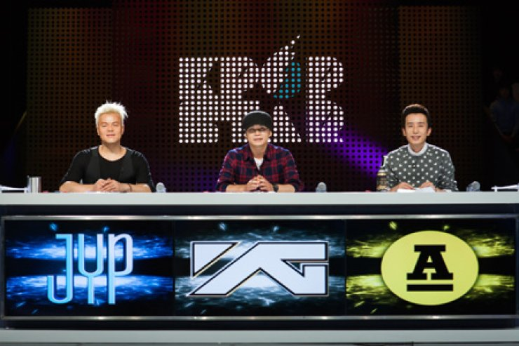 The judges for K-pop Star Season 4: From left, Park Jin-young of JYP Entertainment, Yang Hyun-suk of YG Entertainment and You Hee-yeol of Antenna Music. / Korea Times file