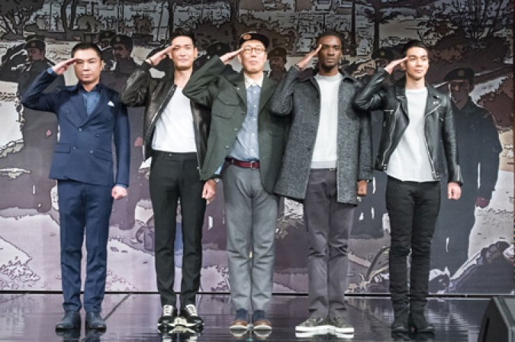 Five celebrities, from left, actor Lim Won-hee, Jeong Kyeo-woon, Kim Young-chul, Sam Okyere and Lee Gyu-han, participating in MBC's entertainment show 'The Real Men 2' salute during the press conference at MBC headquarter in Sangam, Seoul, on March 6. / Courtesy of MBC