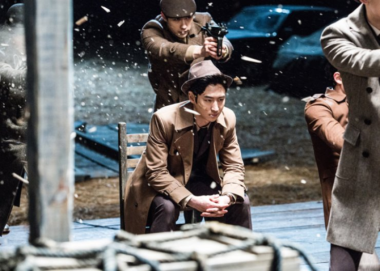 Lee Je-hoon, center, as modern-day Hong Gil-dong in a scene from 'Phantom Detective' / Courtesy of CJ Entertainment