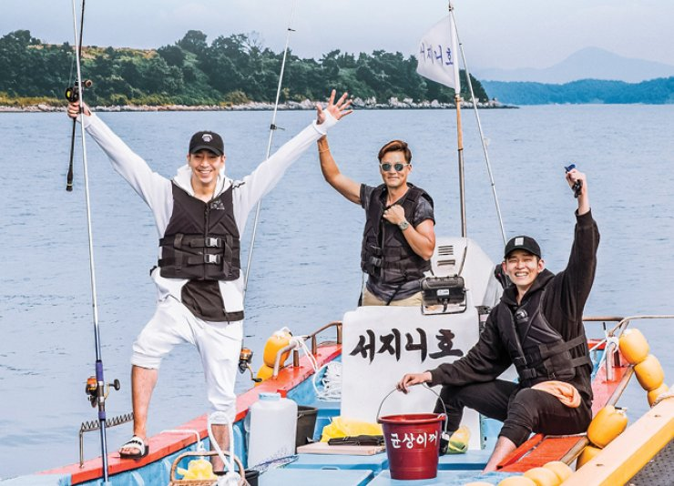 Eric Mun, from left, Lee Seo-jin and Yoon Kyun-sang pose on a boat at Deukryang Island, Goheung, South Jeolla Province, in the season premiere of 'Three Meals a Day.'  / Courtesy of CJ E&M