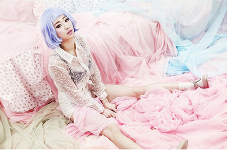 Seen above is a photo from a spread included in the magazine W Korea that girl group 9muses referenced for their album's cover image. The spread was published in 2012.  / Korea Times file