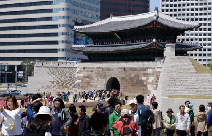 Sungnyemun in central Seoul during its public reopening in May 2013, after a five-year restoration effort following an arson attack in 2008./ Korea Times file