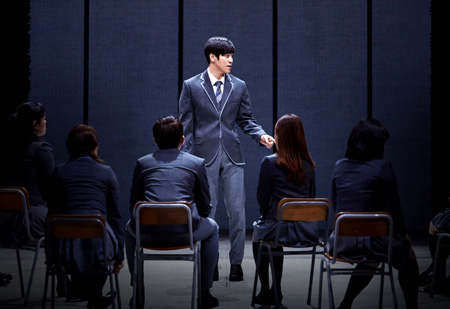 In a scene from the musical 'Death Note,' staged at Opera House of Seongnam Arts Center, detective L, center, played by Kim Jun-su, confronts Light Yagami, second from right, played by Hong Kwang-ho. / Courtesy of CJeS Culture