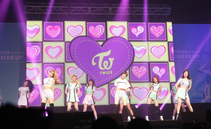 JYP Entertainment's girl band TWICE performs 'Cheer Up' at YES24 Live Hall in Gwangjin-gu, eastern Seoul, Monday.  / Courtesy of JYP Entertainment