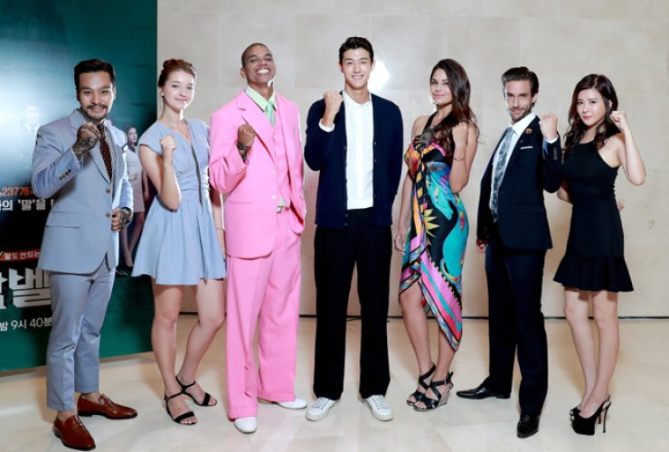The cast members of tvN's new reality show 'Babel 250' pose at a press meeting, Monday. From left are Tanon Varaya, Angelina Danilova, Matheus Oliverio da Silva Rego, Lee Ki-woo, Michelle Marie Bertolini Araque, Nicolas Portier and Chen Lin.  / Courtesy of CJ E&M