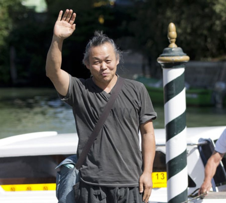 Director Kim Ki-duk arrives at the 70th edition of the Venice Film Festival in Venice, Italy, Monday. The festival, which opened on Aug. 28, will continue through Sept. 7. / AP-Yonhap