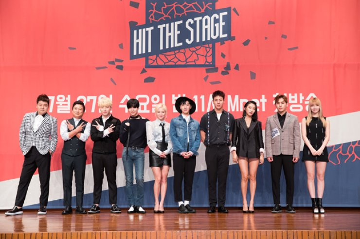 The cast members of Mnet's new dance competition show 'Hit the Stage' pose at a press meeting, July 22. From left are hosts Jun Hyun-moo and Lee Soo-geun and idol dancers U-Kwon, Taemin, Hyoyeon, Ten, Shownu, Bora, Hoya and Momo. / Courtesy of CJ E&M