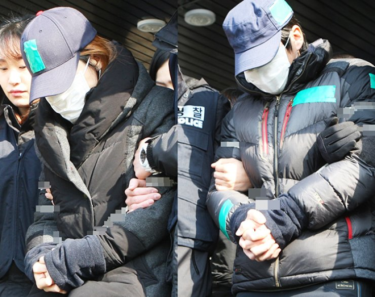 A woman, left, accused of murdering her seven-year-old stepson after months of abuse and neglect, and her husband, right, are taken by police to the prosecutors' office in Pyeongtaek, Gyeonggi Province, Wednesday. / Yonhap