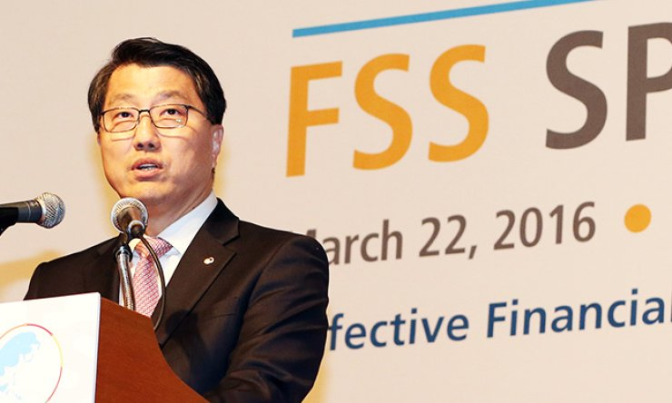 Financial Supervisory Service Gov. Zhin Woong-seob speaks during the financial watchdog's annual policy briefing to foreign financial companies operating in South Korea at a Seoul hotel, Tuesday. / Yonhap