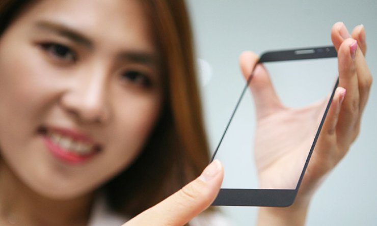 An LG Innotek model promotes its under-glass fingerprint sensor module. The world's largest smartphone camera module maker said Sunday the button-less fingerprint sensor module will help handset makers improve such features as waterproofing and dust protection. / Courtesy of LG Innotek