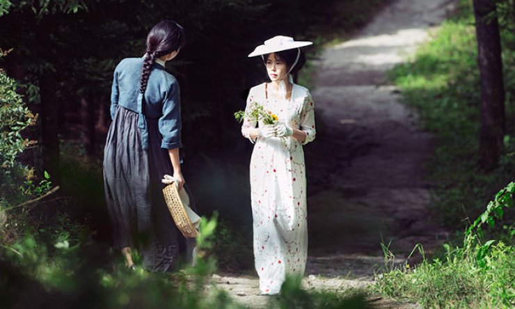 Kim Min-hee, right, delivers one of her strongest performances yet in her most demanding role to date in Park Chan-wook's latest film 'The Handmaiden.' / Courtesy of CJ Entertainment