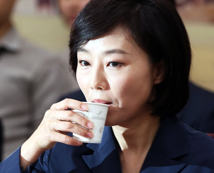 Cho Yoon-sun, the nominee for the minister of culture, sports and tourism, drinks water during her confirmation hearing at the National Assembly in Seoul, Wednesday. / Korea Times photo by Oh Dae-geun