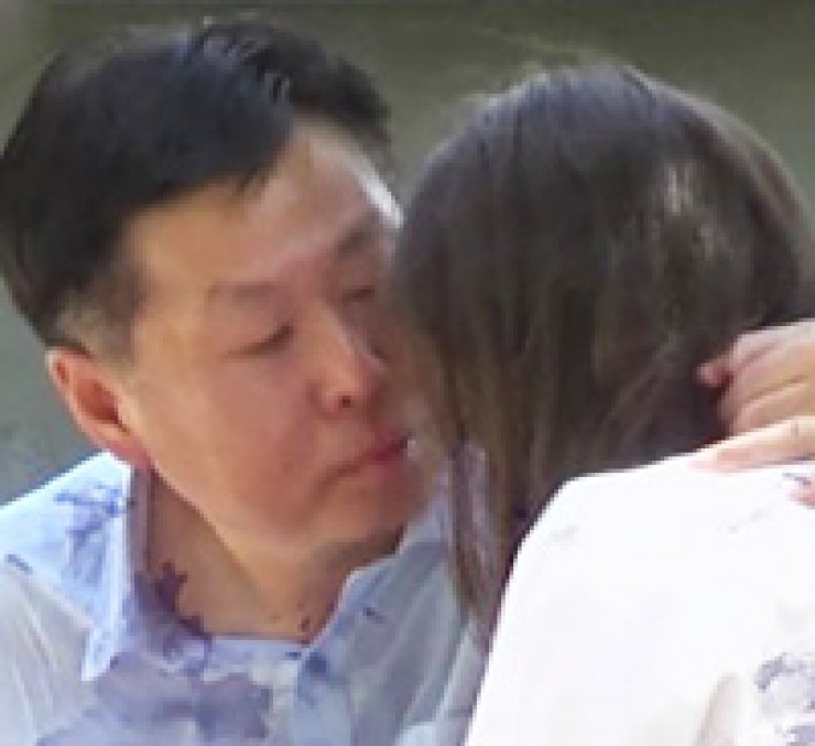 A screengrab from a Chilean TV program showing South Korean diplomat Park Jeong-hak attempting to kiss an actress disguised as a teenage girl.
