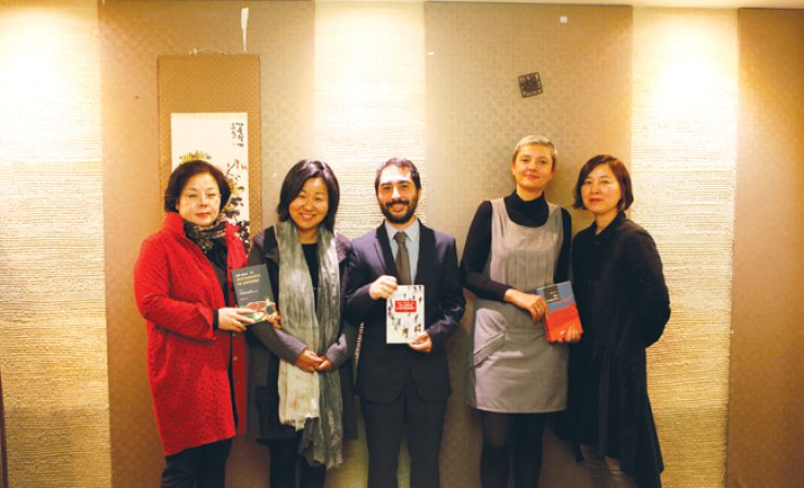 Winners of the 13th Korean Literature Translation Awards pose for a photo at a restaurant in Seoul before the awards ceremony Wednesday. From left are Seong Cho-lim, Kwon Eun-hee, Andrea de Benedittis, Pascale Roux, daughter of Genevieve Roux-Faucard, and Lee Tae-yeon. / Courtesy of LTIK