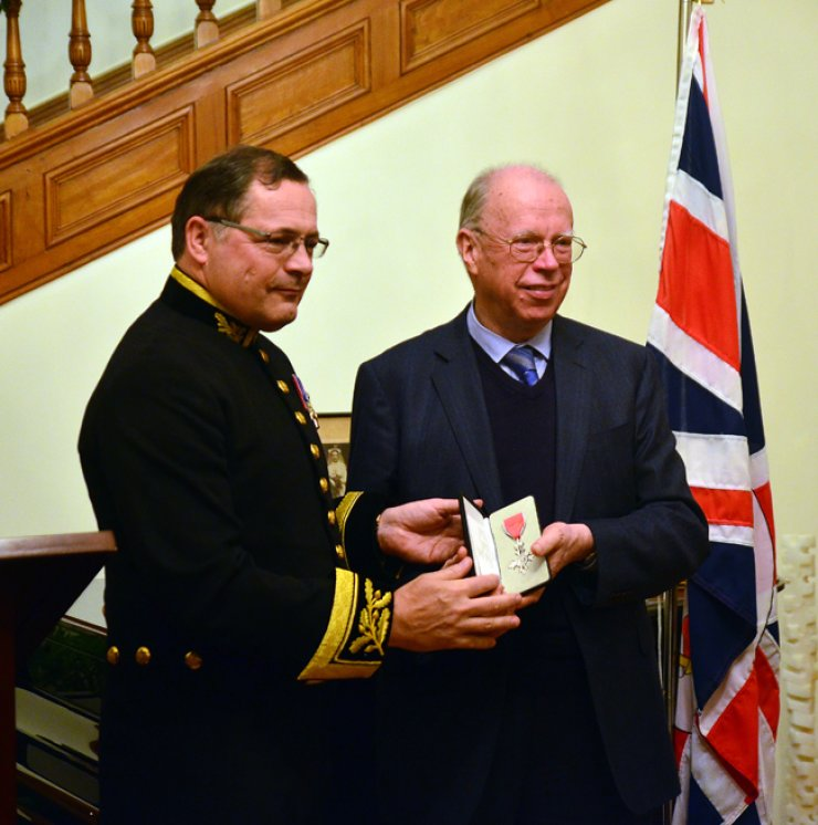 Brother Anthony, right, is presented with a Member of the Most Excellent Order of the British Empire (MBE) by Charles Hay, the British ambassador to Korea, on Dec. 2. / Korea Times photo by John Dunbar