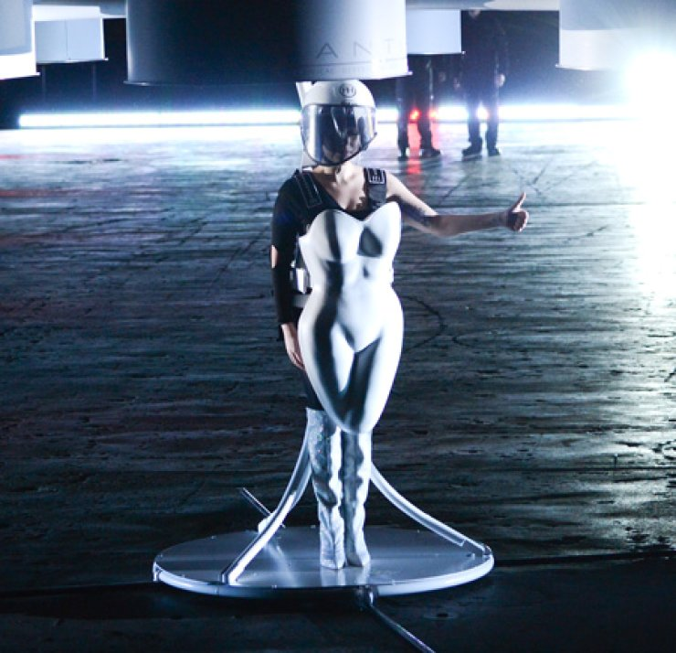 Gaga demonstrates the Volantis transport prototype 'flying dress' designed by TechHaus-Studio XO during the ARTPOP album release and art event at the Brooklyn Navy Yard in New York City, Sunday. / AP-Yonhap
