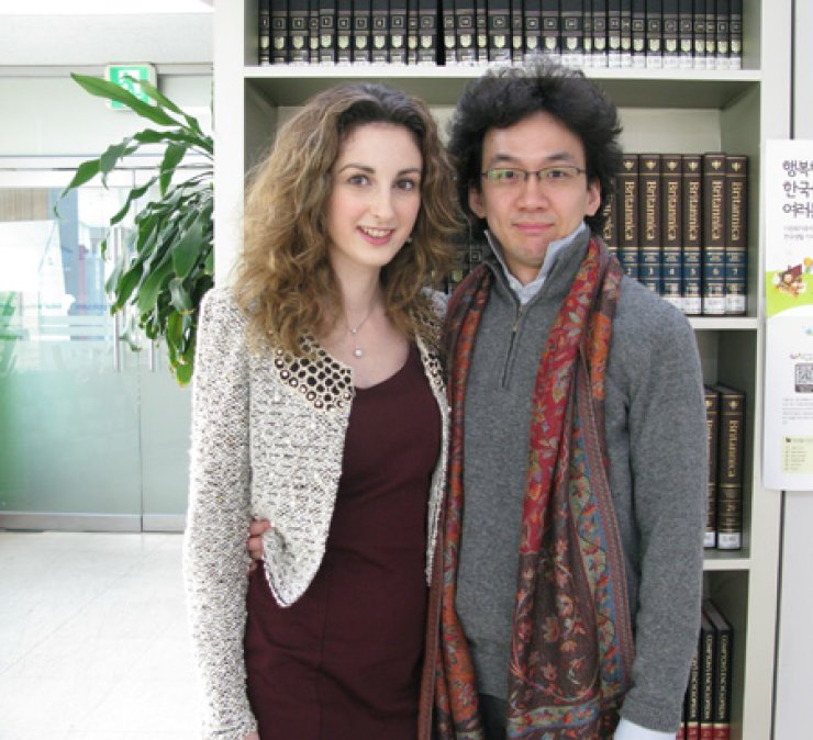 Christina Confalonieri, left, head of the Global Village Center in Yeoksam-dong, Gangnam-gu, poses with her husband Kim Hyun-joon at her office, Monday. Confalonieri, an Italian national, came here with her Korean husband and became the head of the center last year. / Yonhap