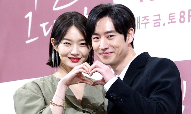 Shin Min-a, left, and Lee Je-hoon pose at a press conference for 'Tomorrow With You,' Monday. / Yonhap