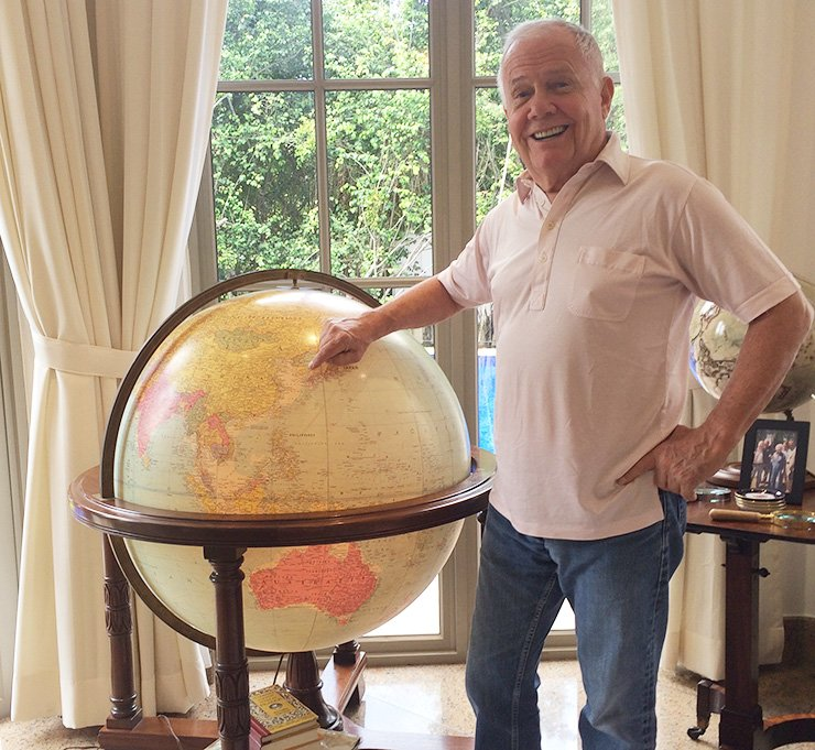 Jim Rogers, chairman of Rogers Holdings, points at the Korean Peninsula on a globe following a recent interview at his residence in Singapore. He said that once unified, he may invest most of his wealth in Korea. / Korea Times photo by Kim Jae-kyoung