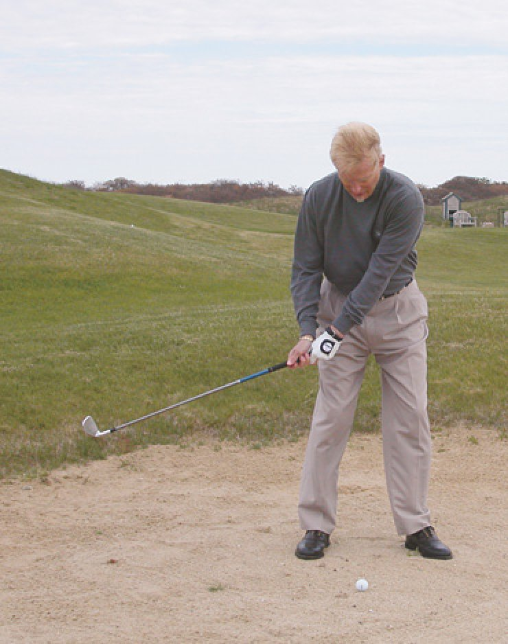 With any correctly struck iron shot, the divot should start at the line. To accomplish this, my goal is to catch the back of the ball using a descending angle of attack.Practicing this drill out of the sand so you can easily see where the divot is will make you a great iron player.