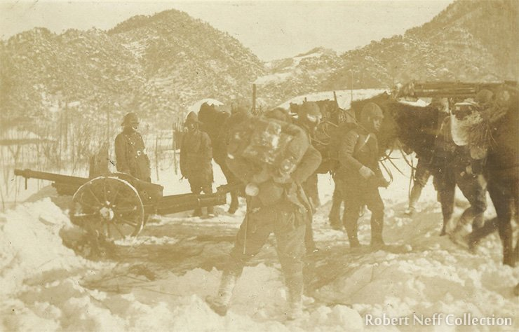 Setting up artillery in the snow.