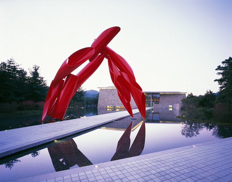 Museum San, located in Wonju, Gangwon Province, is designed by Japanese architect Tadao Ando. Visitors have to pass the Water Garden and Alexander Liberman's red sculpture 'Archway' to reach the museum building. / Courtesy of Museum San