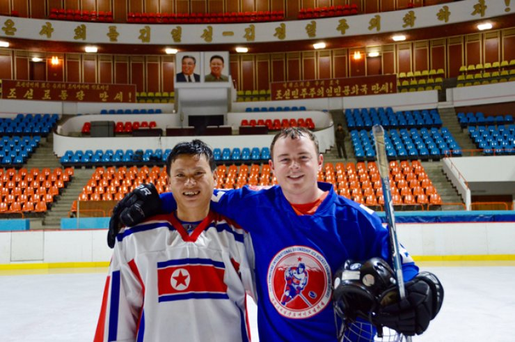 Jordan Ashton, right, a 26-year-old Canadian gym teacher living in South Korea, embraces a member of the North Korean men's national team at the Pyongyang International Friendship Ice Hockey Exhibition (PIFIHE), held in Pyongyang March 7-11. / Courtesy of Paektu Cultural Exchange