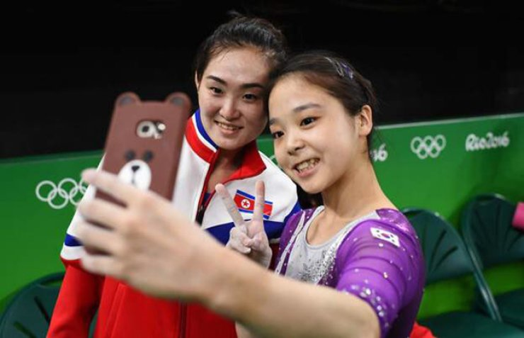 South Korean gymnast Lee Eun-ju, right, poses with North Korea's Hong Un-jong during the artistic gymnastics women's qualification at the Olympic Arena in Rio de Janeiro, Brazil, Aug. 7. / Courtesy of Ian Bremmer's Twitter