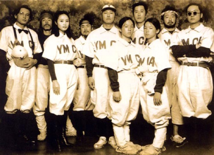 A scene from the 2002 Korean film 'YMCA Baseball Team' shows players wearing a uniform of the YMCA baseball team in the early 20th century. Many believe baseball was introduced to Korea in 1905 by an American missionary with the YMCA, but a new record has been found showing there was a baseballgame in the late 19th century. / Courtesy of CJ E&M