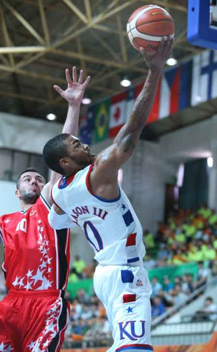 U.S. point guard Frank Mason, right, shoots a layup against the Turkish defense during a preliminary round group D match at the Dongkang College Gymnasium in Gwangju, Saturday. / Courtesy of GUOC