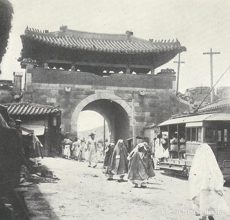 A streetcar passing through the West Gate, circa 1900.