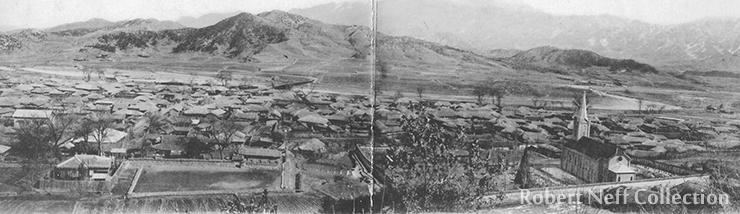 'You can see that most of the houses are thatched; but they are nearly all large for Korean homes.' Looking east from the Morris residence, circa 1924.