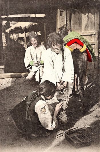 A blacksmith shoeing a Korean pony, circa early 1900s. Robert Neff Collection
