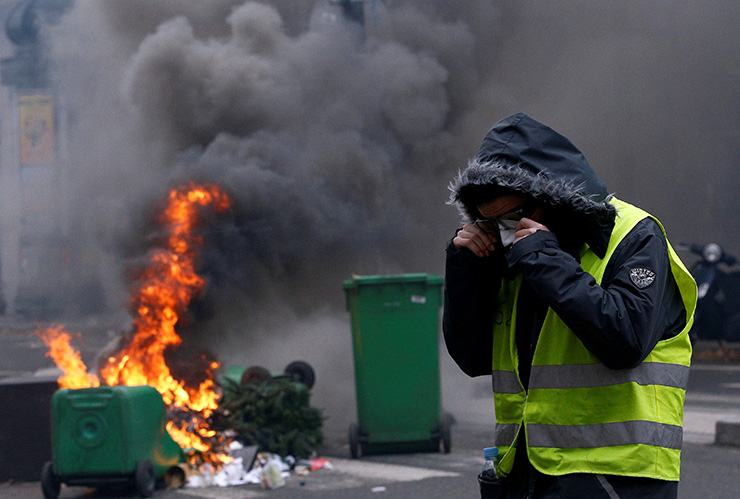 A car burns during during clashes with police at a demonstration of the 'yellow vests' movement in Marseille, France, Dec. 8. Reuters