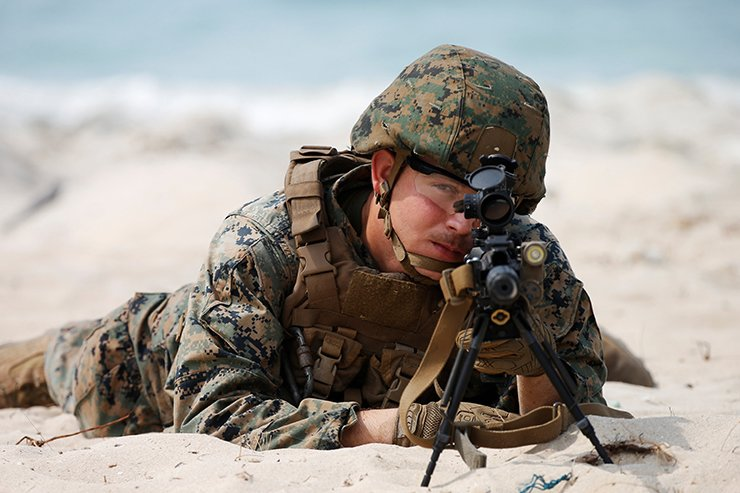A soldier takes part in the Amphibious Assault Demonstration during the Cobra Gold multilateral military exercise on Hat Yao Beach, Sattahip District, Chonburi Province, Thailand, February 16, 2019. Reuters