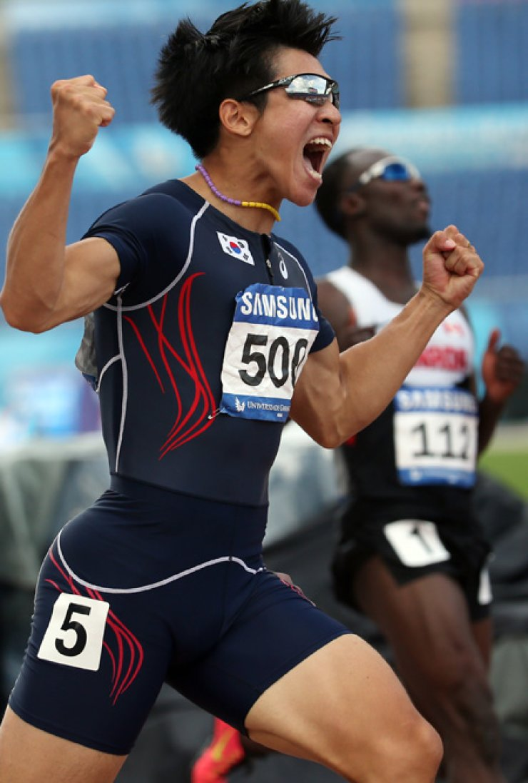 Sprinter Kim Kuk-young celebrates after setting a national record in the men's 100m sprint at the Gwangju Universiade Main Stadium, Thursday. He finished his semifinal run in 10.16 seconds. / Courtesy of GUOCTaekwondo practitioner Kim Min-jeong celebrates with the Korean flag afterwinning gold in the women's -53kg event at the Chosun University Gymnasium in Gwangju, Sunday. / Courtesy of GUOCJin Min-sub competes in the men's pole vault final at the Gwangju Universiade Main Stadium in Gwangju, Saturday. / Courtesy of GUOCRhythmic gymnast Son Yeon-jae competes in the individual all-around final at the Kwangju Women's University Gym in Gwangju, Saturday. / Courtesy of GUOCChina's Xie Sichao, left, offers Russia's Maksimov Vladislav a sponge soaked in water during their men's 20km walk at the Gwangju Universiade Main Stadium in Gwangju, Thursday. / Courtesy of GUOC