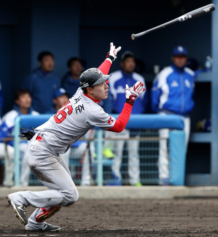 SK Wyverns infielder Yoo Seo-jun hits a homerun during a practice match with the Samsung Lions in Okinawa, Japan on Monday. / Yonhap