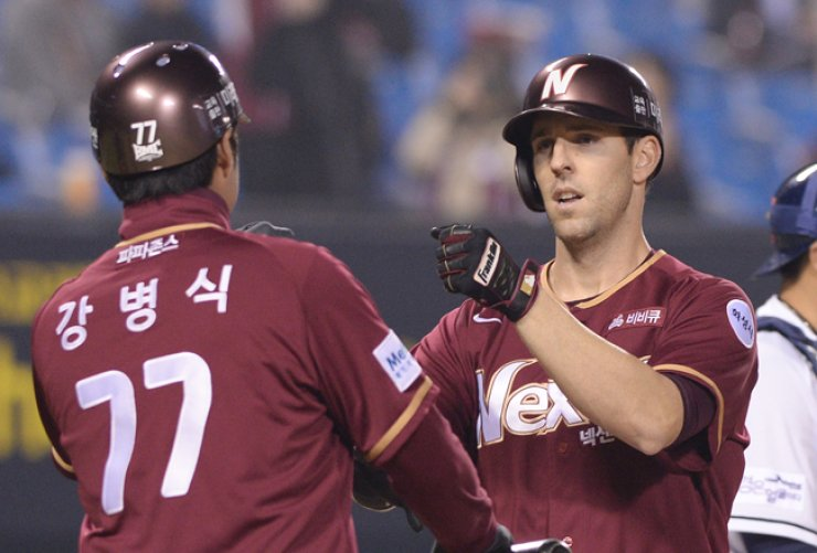 The Nexen Heroes' Danny Dorn, right, celebrates after hitting a home run in the top of the seventh inning during his team's game against the Doosan Bears at Jamsil Baseball Stadium in Seoul, Friday. / Yonhap