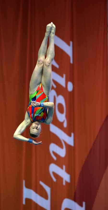 Divers practice ahead of the women's 1m springboard final of the 2015Gwangju Universiade at the Nambu University Aquatics Center, Saturday. Kim Na-mi won silver to become the first Korean athlete to medal at the Universiade. / YonhapGymnast Lee Hyeok-jung applies magnesium carbonate powder to hishands before competing in the parallel bars of the men's qualifications and team final at the Kwangju Women's University Gym, Sunday. / YonhapKorean judoka Wang Ki-chun falls to his knees after losing to Khasan Khalmurzaev of Russia in the men's -81kg gold medal match at the Yeomju Bitgoeul Gymnasium, Sunday. / YonhapFrench judoka Nabil Zalagh celebrates after winning by an ippon againstEstonian Juhan Mettis in the men's +100kg bronze medal match at the Yeomju Bitgoeul Gymnasium, Saturday. / YonhapPhilipp Martin Seidel of Germany extracts empty cartridges after the men's trap event at the Naju Jeollanamdo Shooting Range, Monday. / YonhapThe Australian water polo team leaves the pool area after their preliminarygroup A match against Hungary at the Yeomju Indoor Aquatics Center,Saturday. They tied 8-8. / Korea Times photo by Shim Hyun-chulRussia's Elina Ridel competes in the preliminary round of the women's platform diving  event at the Nambu University Aquatics Center, Sunday. / Korea Times photo by Shim Hyun-chul