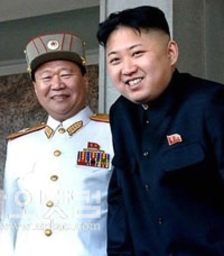 The Korean People's Army Chief Choe Ryong-hae, left, with Kim Jong-un