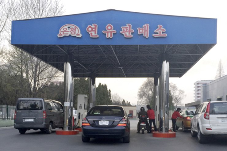 Cars refuel at a gas station in North Korea's capital of Pyongyang. Gas prices in the city are reported to be stable despite new U.N. sanctions including putting a limit on oil imports. / Korea Times file