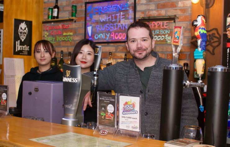 Chad Murphy, owner and manager of the Bull & Barrel, with staff in Itaewon. / Photo by John Redmond