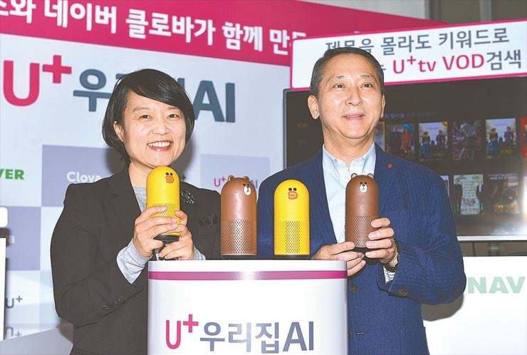 LG Uplus CEO Kwon Young-soo, right, and Naver CEO Han Seong-sook pose with the mobile carrier's new AI speaker Friends Plus during a launch event at its headquarters in Seoul, Monday. / Courtesy of LG Uplus